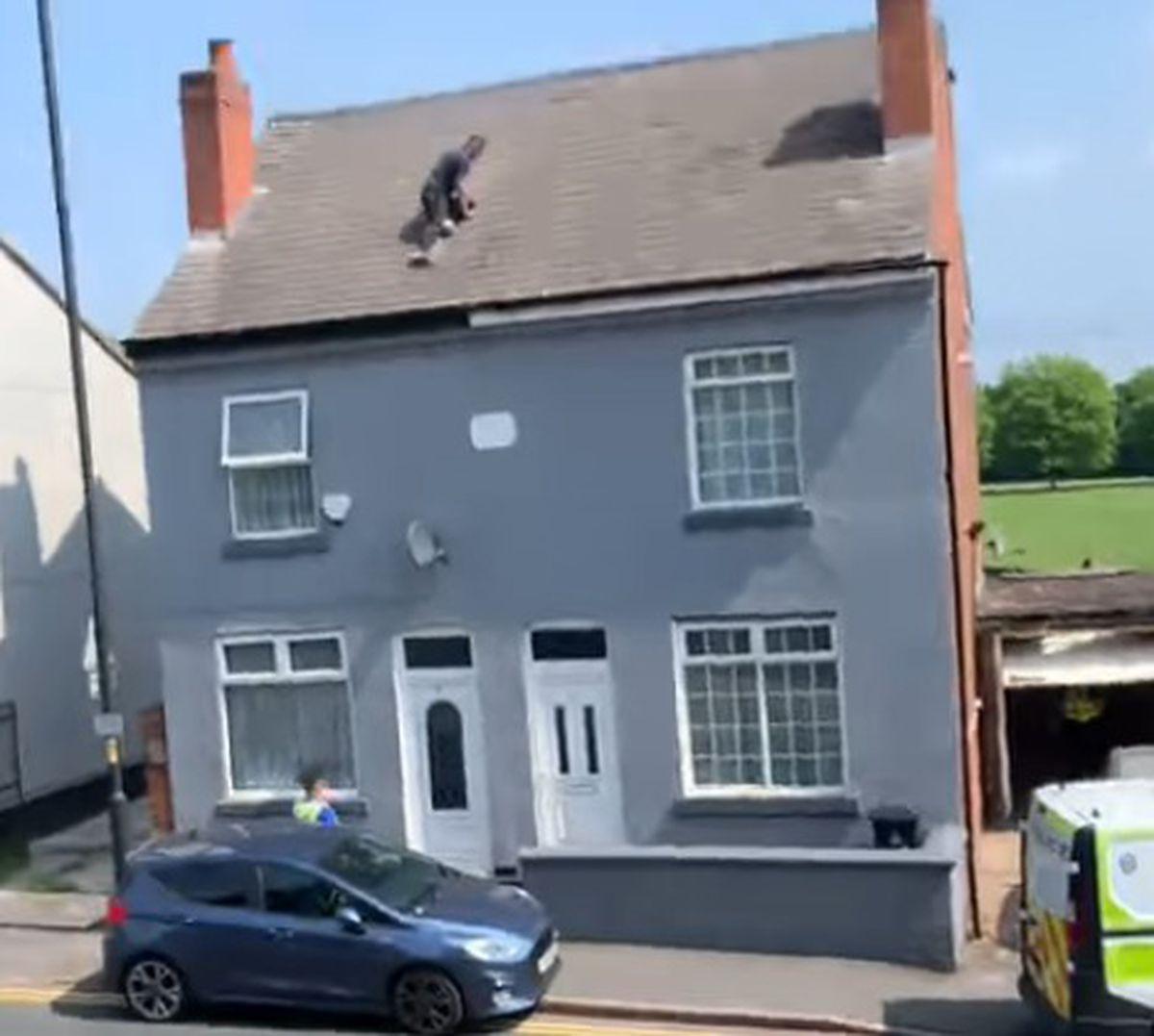 The man on the roof. Photo: Arviee Arrowsmith/Facebook