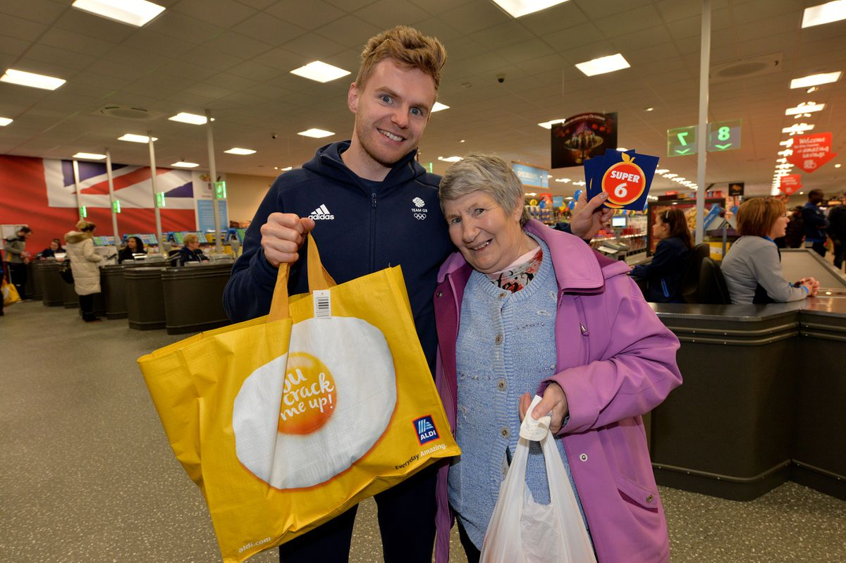 Marcus Ellis with shopper Dorothy Firm