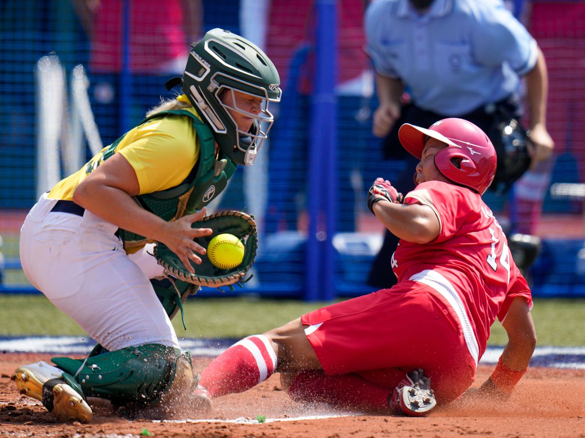 Tokyo 2020 got under way with softball action