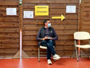 A man waits to get vaccinated with the AstraZeneca Covid-19 vaccine in a vaccination centre of Saint-Jean-de-Luz, south-western France