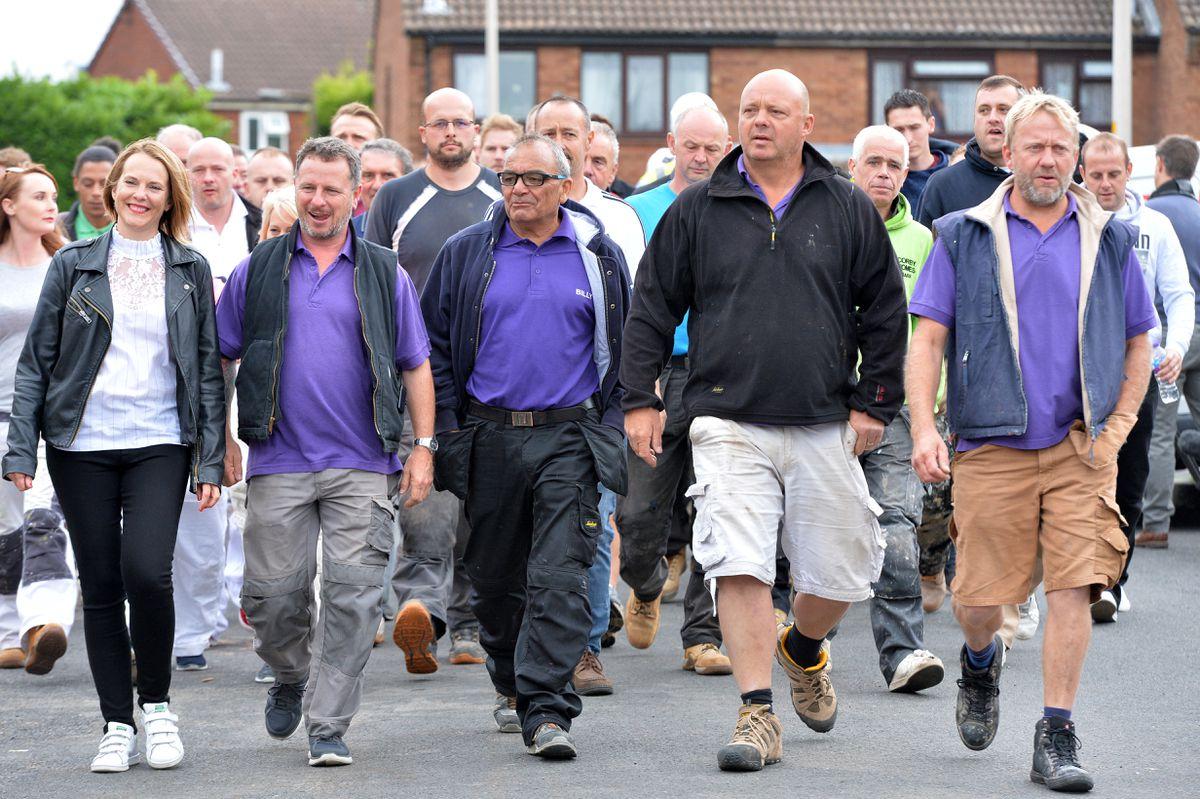The DIY SOS team walk to meet the family