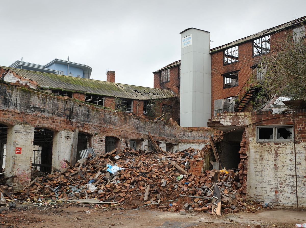 A view of the arson hit derelict building, William House, Walsall, from Marsh Lane
