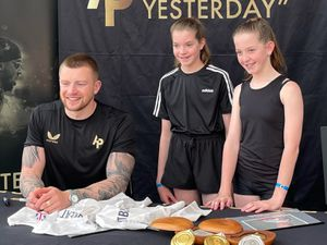 Madison and Daisy May-Price with Adam Peaty