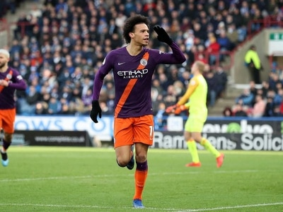 City keep pressure on Liverpool with routine win at Huddersfield