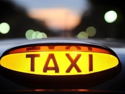 Two men charged after female taxi driver robbed
