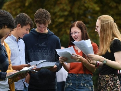 Top GCSE grades rise for second year in a row after exam shake-up