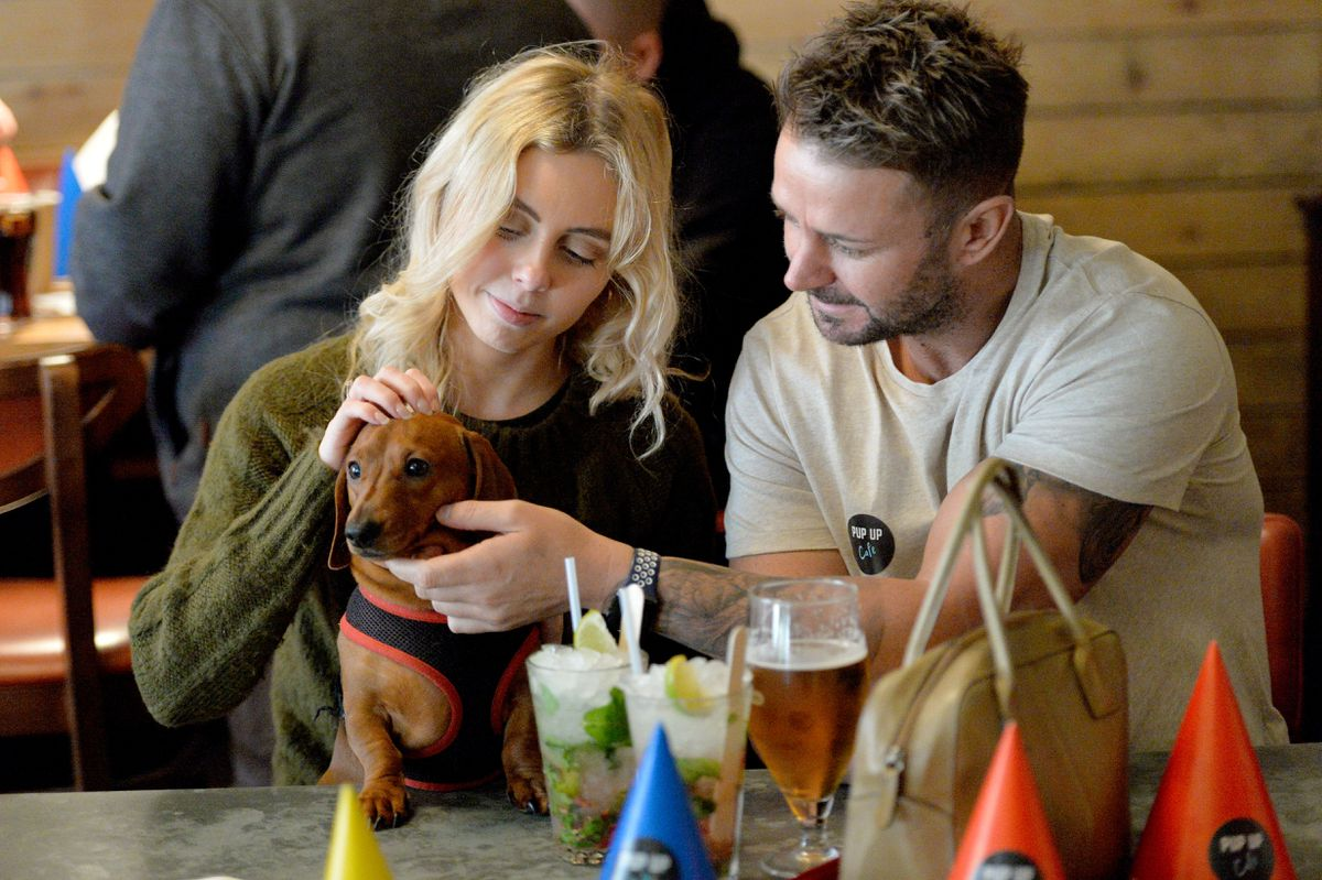 Dachshund Pop Up Cafe at Revolution, Stafford. Winston with his owners, Chloe Plant and Sean Boote
