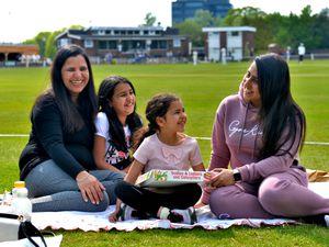Veerpal Kaur, Ekam Kaur, 10, Avneet Kaur, five, and Arpita John lap up the sunshine at West Bromwich Dartmouth Cricket Club