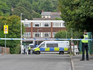The police cordon in Oldbury after a man was shot