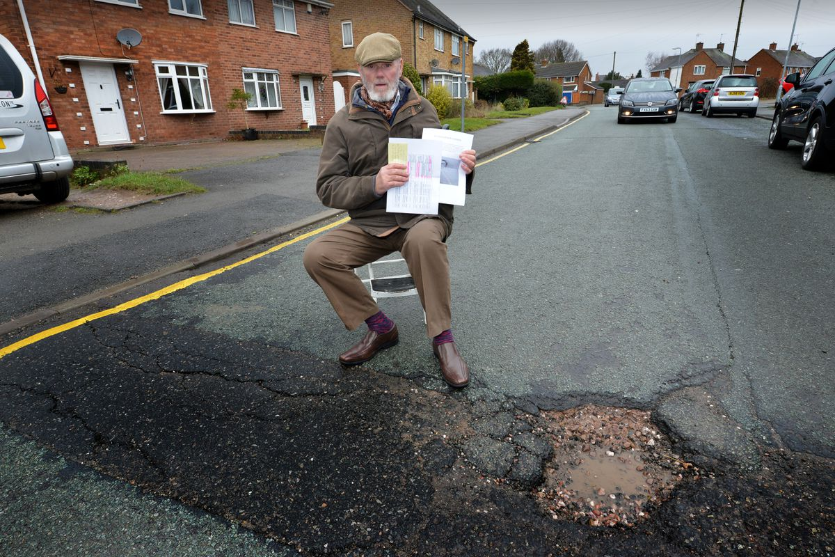 Councillor Gordon Alcott in 2016 campaigning against the pothole problem in the district