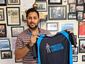 Shaz Saleem with the Prostate Cancer UK shirt given to those completed the challenge
