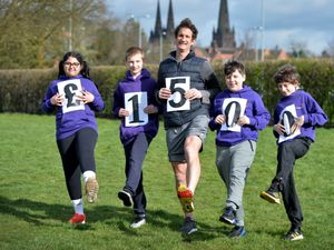 LICHFIELD  COPYRIGHT TIM STURGESS EXPRESS AND STAR...... 25/03/2021  Pupils at Queen's Croft High School, Lichfield, have helped raise more than £1,500 for St Giles Hospice by walking. Pictured is PE teacher George Pilkinton with yera 7 students...