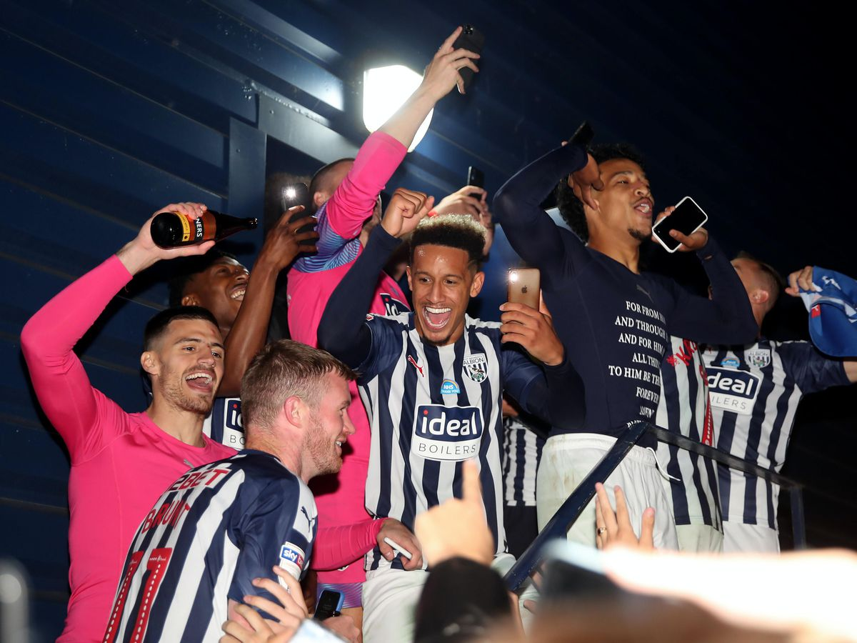 West Brom players celebrate winning promotion from the Sky Bet Championship