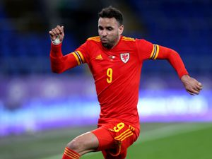 File photo dated 27-03-2021 of Wales' Hal Robson-Kanu. Issue date: Monday March 29, 2021. PA Photo. Hal Robson-Kanu, Rabbi Matondo and Tyler Roberts have been sent home for breaching Football Association of Wales protocol and will miss Tuesday's World Cup qualifier against the Czech Republic. See PA story SOCCER Wales Players. Photo credit should read David Davies/PA Wire.