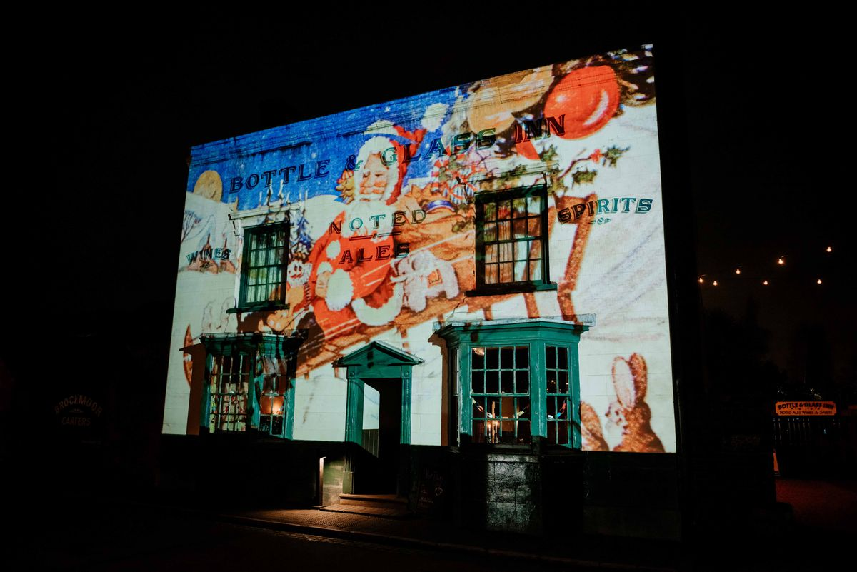 The Black Country Living Museum's Bottle & Glass Inn is lit up for Christmas Nights