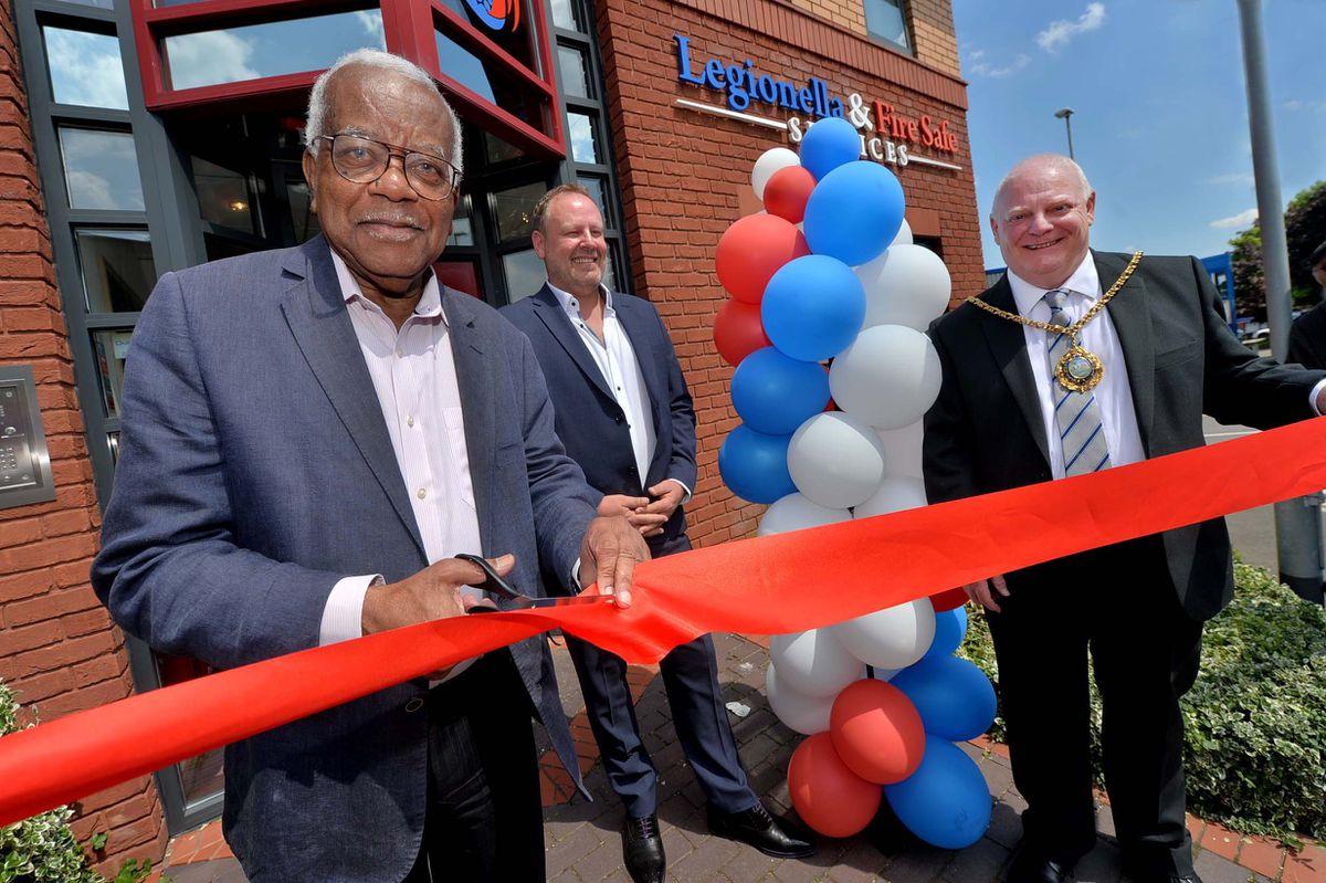 Sir Trevor McDonald cuts the ribbon with MD Steve Morris and the Mayor Councillor Robert Yardley..