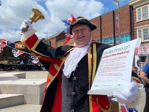 Dudley's town crier Ian Jones announcing the bid for city status