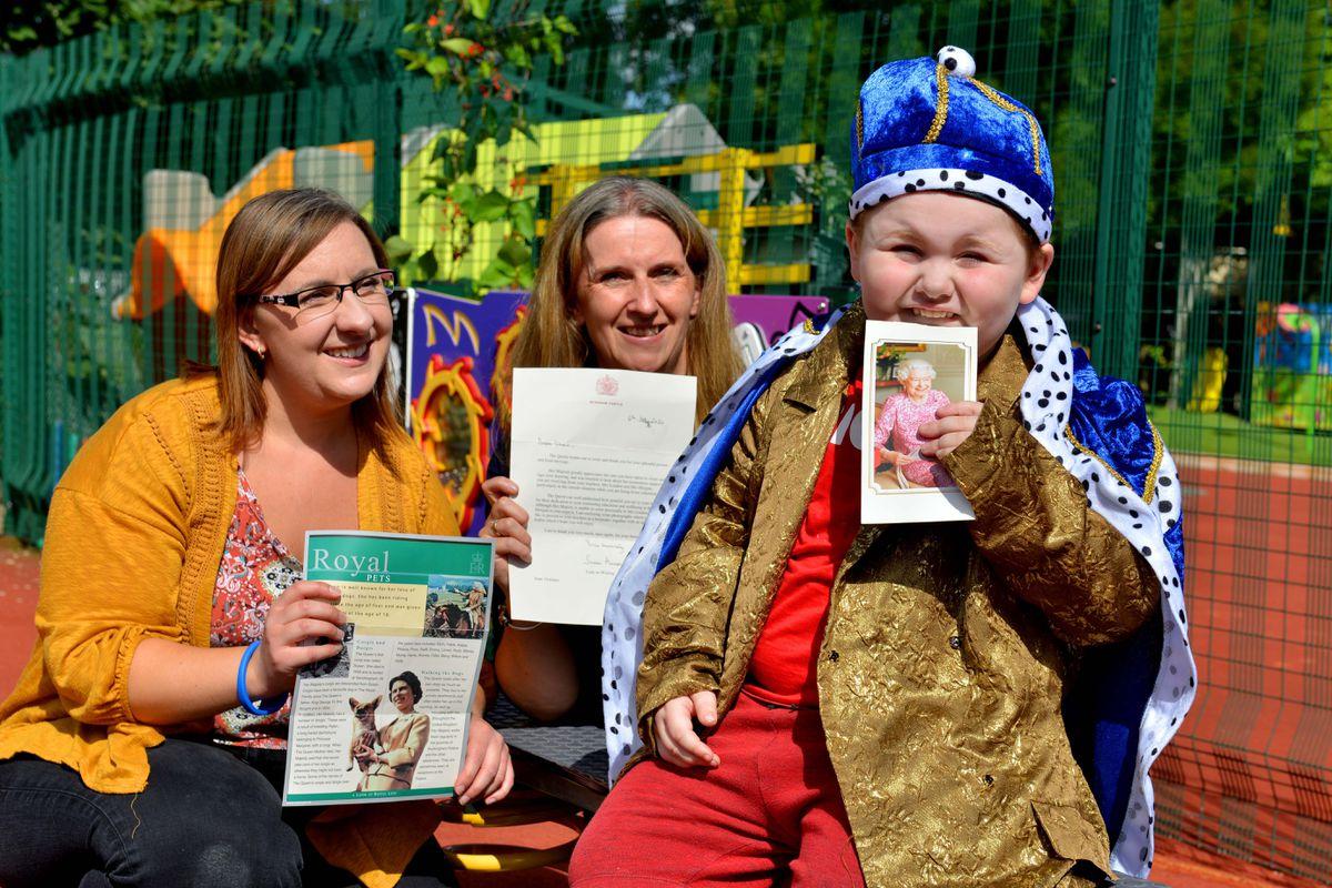 Isaac with school staff Charlotte Morgan and teacher Beth Landon