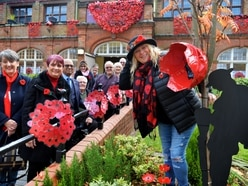 Knitwear and bottles used for 10,000-poppy display in Darlaston