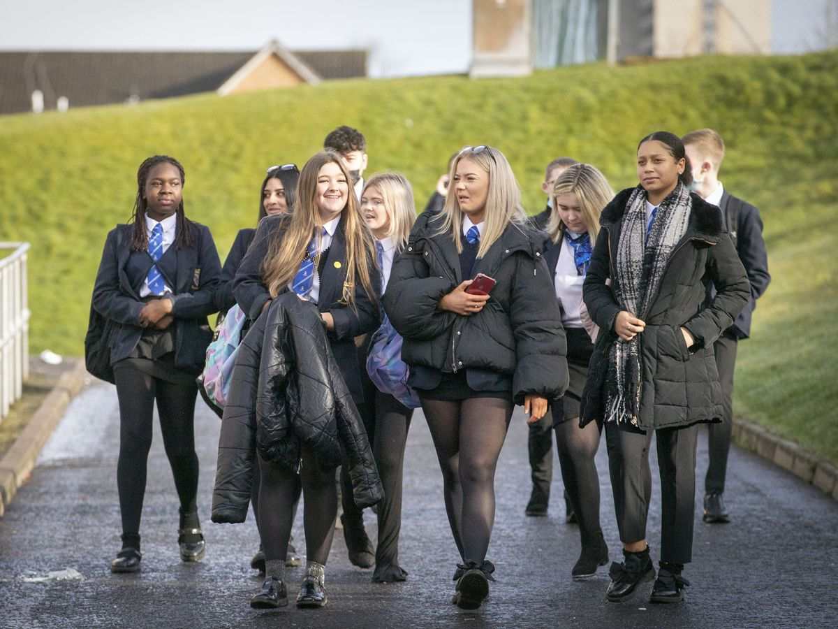 Students arrive at St Andrew's RC Secondary School in Glasgow