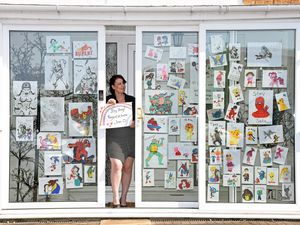 Mandy Rayner has been making window displays for children using pictures of superheroes and other favourite characters.
