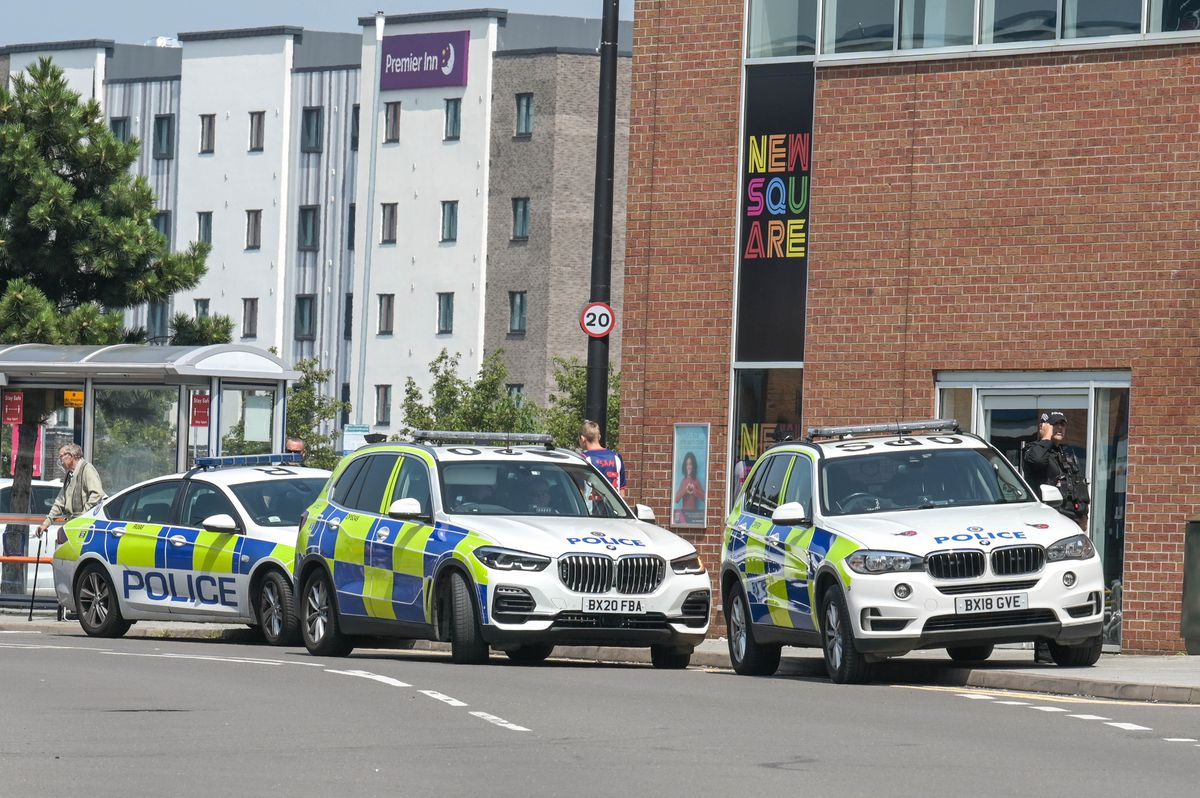 Police outside New Square Shopping Centre in West Bromwich. Photo: SnapperSK