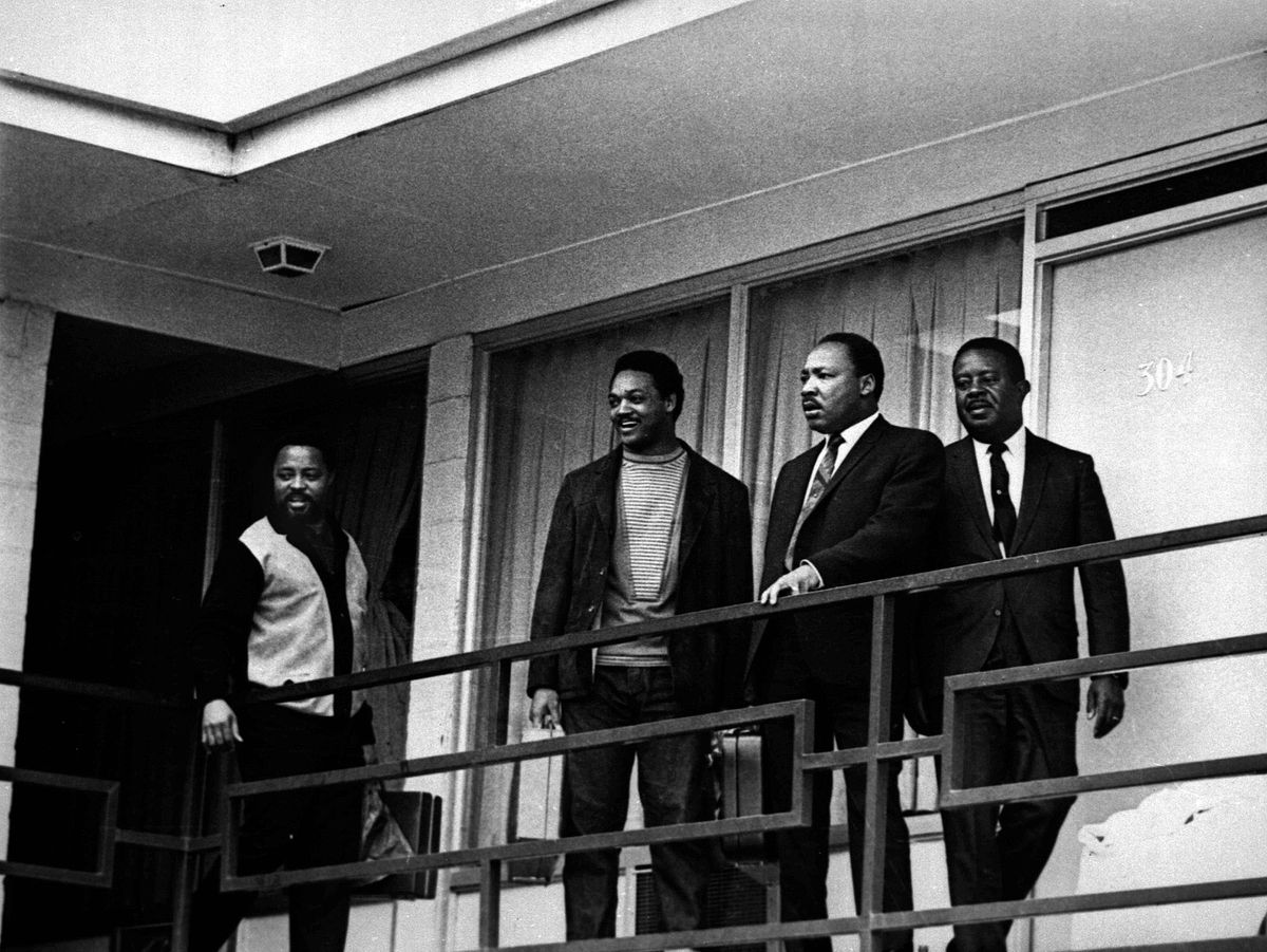 The Rev. Martin Luther King Jr., second right, stands with other civil rights leaders on the balcony of the Lorraine Motel in Memphis, Tenn., in this April 3, 1968, file photo, a day before he was assassinated at approximately the same place.  From left are Hosea Williams, Jesse Jackson, King, and Ralph Abernathy