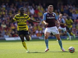 """Watford's Peter Etebo (left) and Aston Villa's John McGinn in action during the Premier League match at Vicarage Road, Watford. Picture date: Saturday August 14, 2021. PA Photo. See PA story SOCCER Watford. Photo credit should read: Jonathan Brady/PA Wire...RESTRICTIONS: EDITORIAL USE ONLY No use with unauthorised audio, video, data, fixture lists, club/league logos or """"live"""" services. Online in-match use limited to 120 images, no video emulation. No use in betting, games or single club/league/player publications.."""