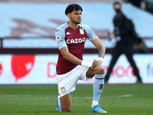 Aston Villa's Tyrone Mings takes a knee