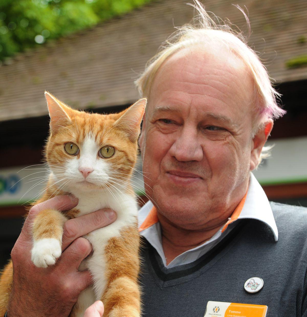 Stourbridge Junction station supervisor Ian Tomlinson with George the station cat
