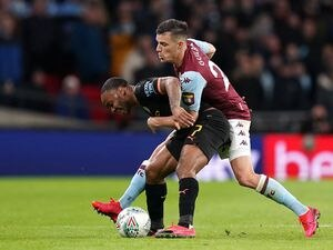 """Manchester City's Raheem Sterling (left) and Aston Villa's Frederic Guilbert battle for the ball during the Carabao Cup Final at Wembley Stadium, London. PA Photo. Picture date: Sunday March 1, 2020. See PA story SOCCER Final. Photo credit should read: John Walton/PA Wire. RESTRICTIONS: EDITORIAL USE ONLY No use with unauthorised audio, video, data, fixture lists, club/league logos or """"live"""" services. Online in-match use limited to 120 images, no video emulation. No use in betting, games or single club/league/player publications."""