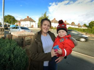 Standing next to a post rebuilt after a car crashed into it is Dangerfield Lane resident Jamie Paskin and son Jack