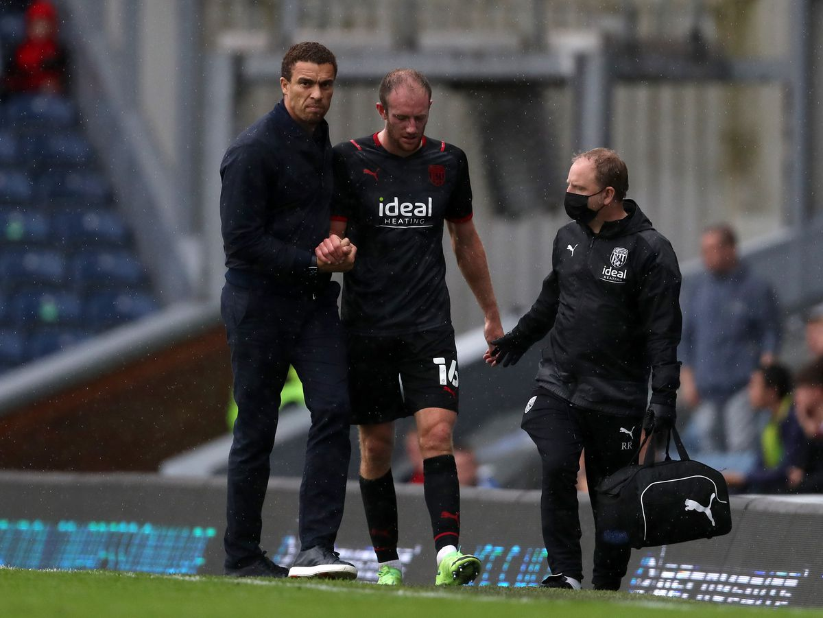Valerien Ismael Head Coach / Manager of West Bromwich Albion helps Matt Clarke off the pitch after he was forced off with an injury (AMA)