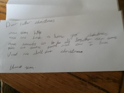 Child, seven, writes to Father Christmas asking for house and food