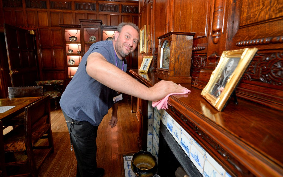 Visitor assistant Neil Pettey working in the dining room at Bantock House Museum