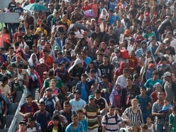 Migrants resume advance towards US border after crossing into Mexico