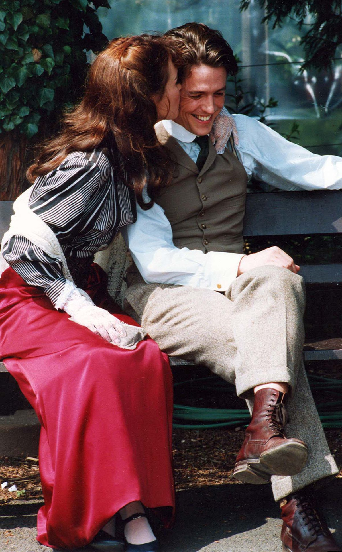 """Hugh Grant gets a quick kiss  from Tara FitzGerald before filming started on """"The Englishman Who Went up a Hill  But Came down a Mountain"""" on the Severn Valley Railway in July 1994."""
