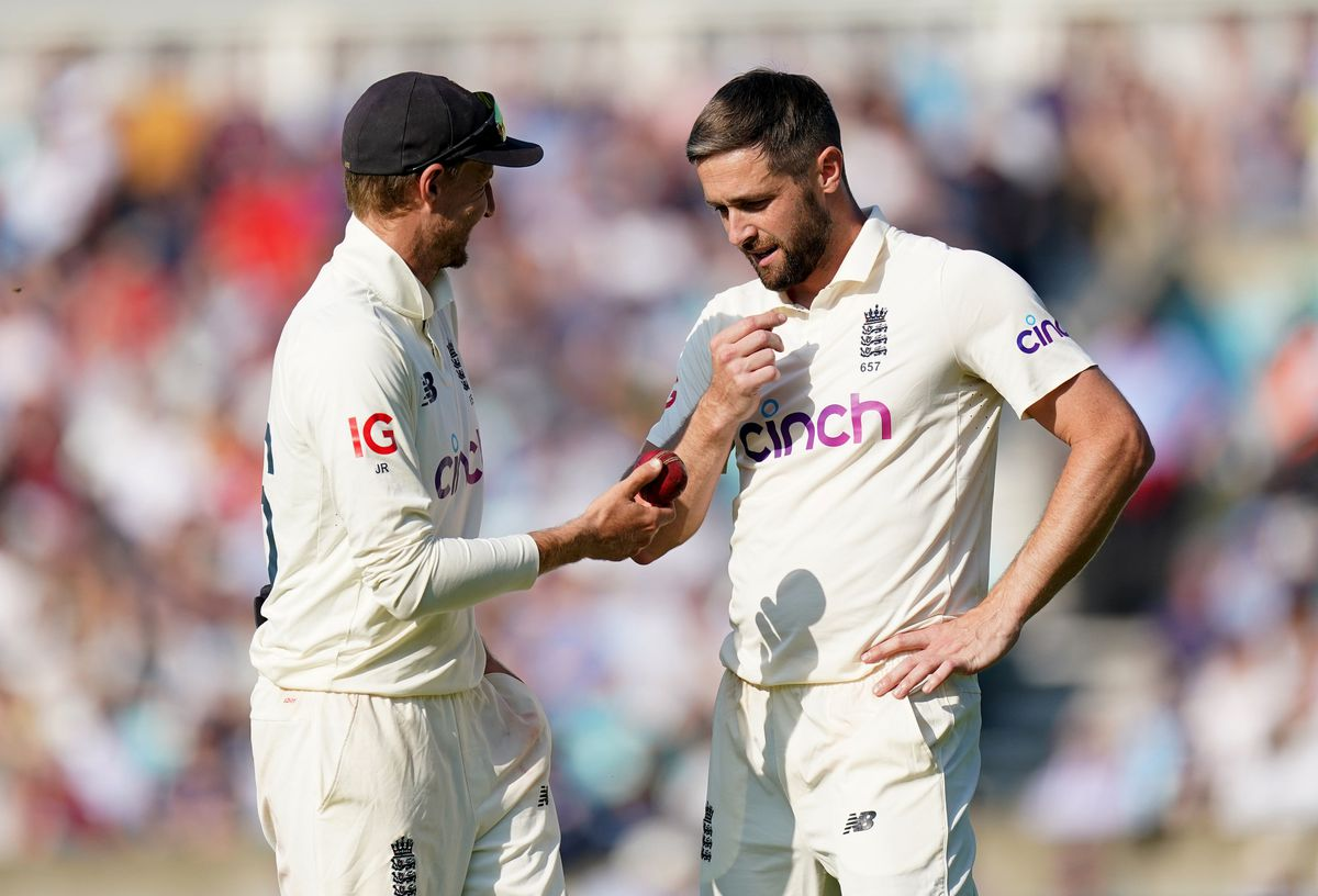 England's Joe Root (left) and Chris Woakes during day four of the cinch Fourth Test