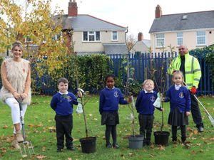 Councillor Beverley Momenabadi at a tree planting event at Bilston CE Primary School