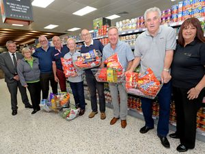 Former Wolves players Geoff Palmer, Willie Carr, John McAlle, Steve Daley and Phil Parkes, with some of the donated food from Co-op Codsall, and staff from the store, for the former players Golf Day