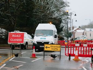 Workers at the scene of the burst water pipe on Monday afternoon