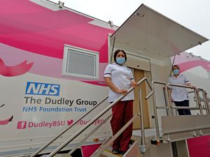 Mammographers Ify Uchenna and Jane Leek with the mobile breast screening unit at Morrisons in Bilston