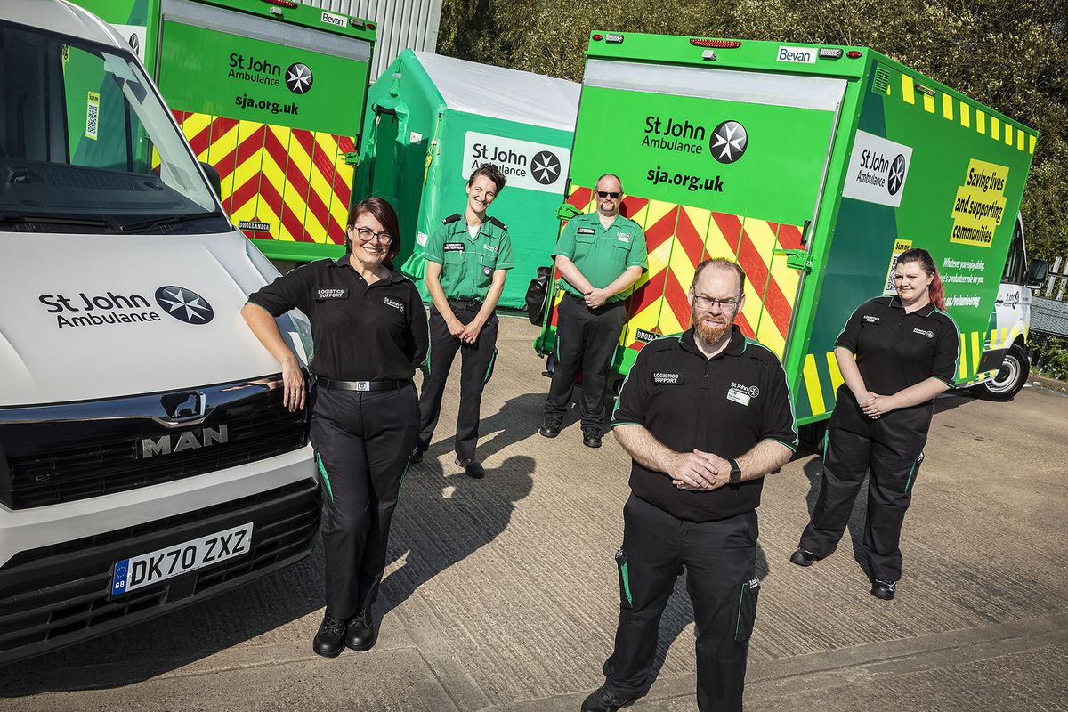 Vehicles at the St John volunteering, training and operational facility in West Bromwich are, from left, District Lead Sam Blaze, Logistics Team Member Katie Bird, Logistics Team Member Tom Lander, Logistics Manager Paul Pearce, and Logistics Officer Carrie Eagleton