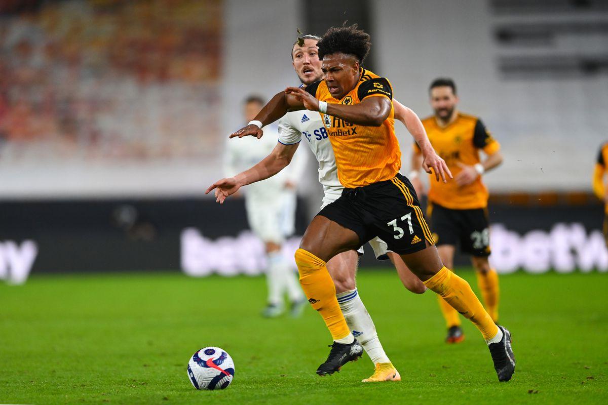 Luke Ayling of Leeds United and Adama Traore of Wolverhampton Wanderers (AMA)