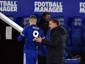 Leicester manager Brendan Rodgers speaks to Jamie Vardy after substituting the striker