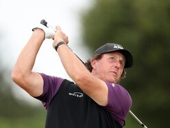 Watch Phil Mickelson hit a ball over a fellow golfer's head from a metre away
