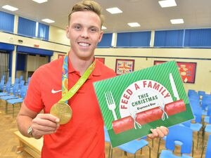 Olympic gold medallist Joe Clarke lends his support to the Express & Star's feed a Family at Christmas campaign as he pays a visit to Hednesford Valley High School