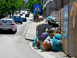 Bosnian city popular with tourists awash with rubbish amid landfill protest
