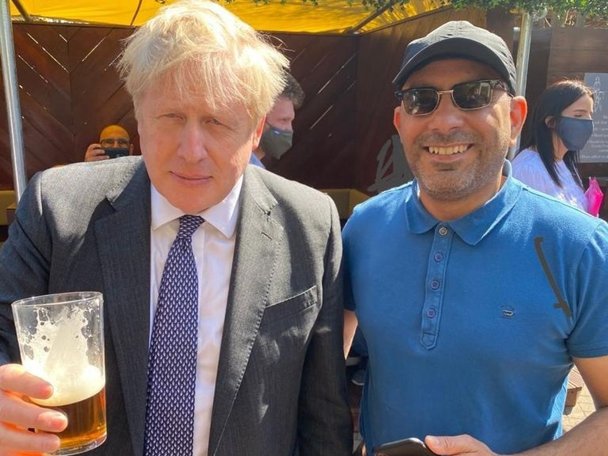 Mr Johnson having a pint at The Mount Tavern in Penn, photographed with Mr P Gill (Image: Mr Gill)