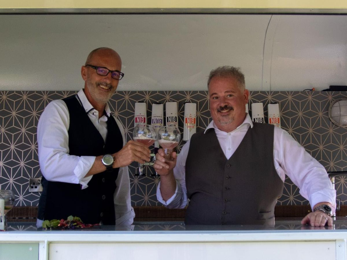 Mark Chambers (CEO) and Neil Harrison (master distiller) share a toast before social distancing measures were introduced